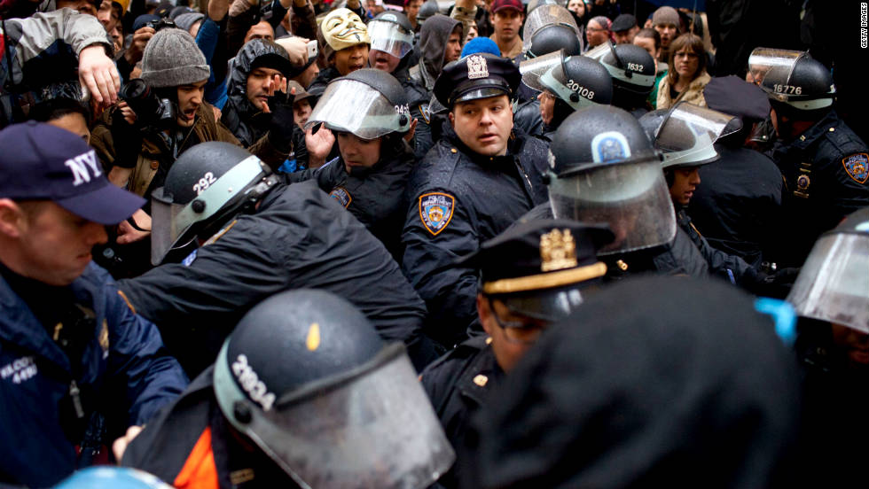 Police officers clash with Occupy Wall Street protesters in New York's Zuccotti Park on Thursday, November 17.