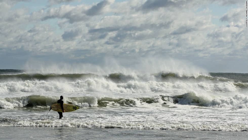 "Michael Duggan took a photo of a New England surfer taking on a Nor'easter. ""I love the North Shore [near] Boston. There is a lot of history, the people are friendly and the beaches are great."""