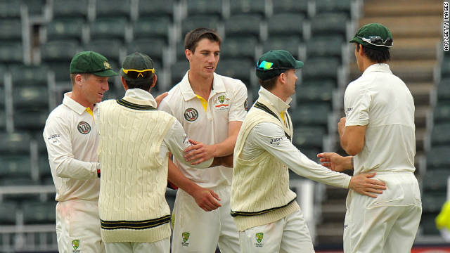 Teenage pace bowler Pat Cummins (center) celebrates taking the wicket of Dale Steyn as the second Test remains finely poised.