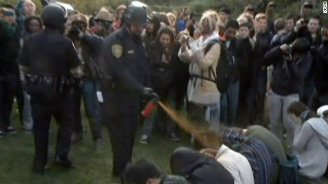 A police officer pepper sprayed protesters at an Occupy encampment on the University of California Davis campus last year.