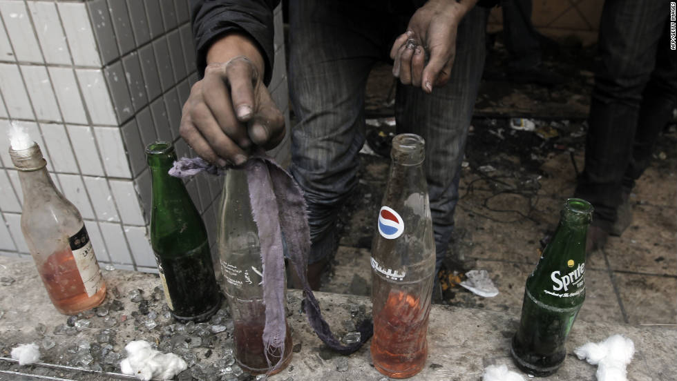 An Egyptian protester prepares Molotov cocktails Wednesday near Tahrir Square.
