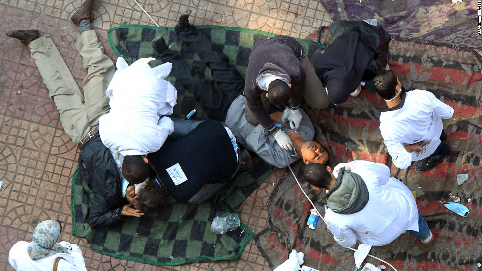 Doctors at a makeshift hospital in Tahrir Square tend to protesters hit by tear gas on Wednesday.