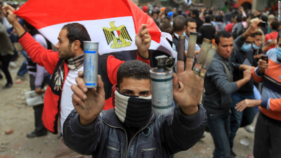 An Egyptian protester shows rubber bullet shells and tear gas canisters during clashes with riot police at Cairo's Tahrir Square on November 20, 2011.