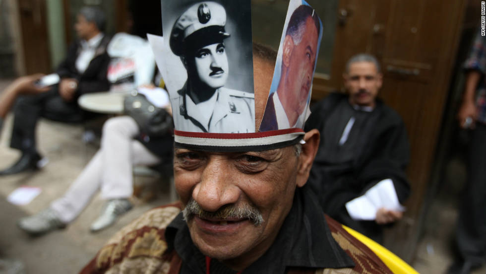 An Egyptian protester wears pictures of former Egyptian president Gamal Abdel Nasser during a rally in Cairo's Tahrir Square on November 18, 2011.