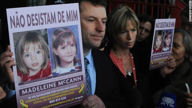 Gerry McCann and his wife, Kate, hold signs showing their missing daughter, Madeleine, in Lisbon in February 2010.