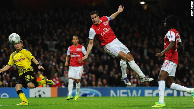 Robin van Persie scores one of his 37 goals for Arsenal last season.
