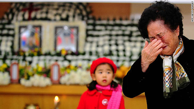 A relative of a marine killed by North Korean shelling on Yeonpyeong weeps during a memorial service on November 25, 2010.