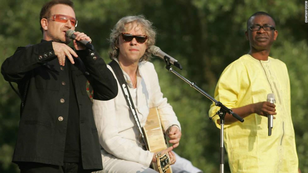 Senegal's Youssou N'Dour (right) has been one of Africa's leading and most recognizable musicians for more than two decades. Here he performs alongside rock legends Bono and Bob Geldof in Germany, 2007.