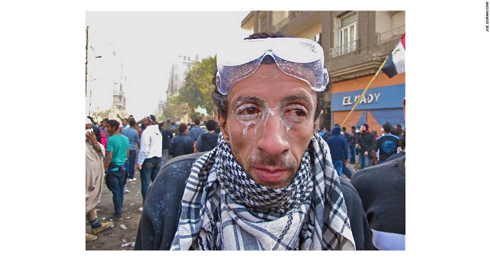 An Egyptian shows the residue on his face Wednesday after police used tear gas during clashes with protesters.