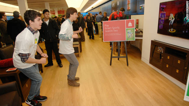 Customers play a Kinect dance game at the grand opening of the 14th Microsoft Store in McLean, Virginia last week.