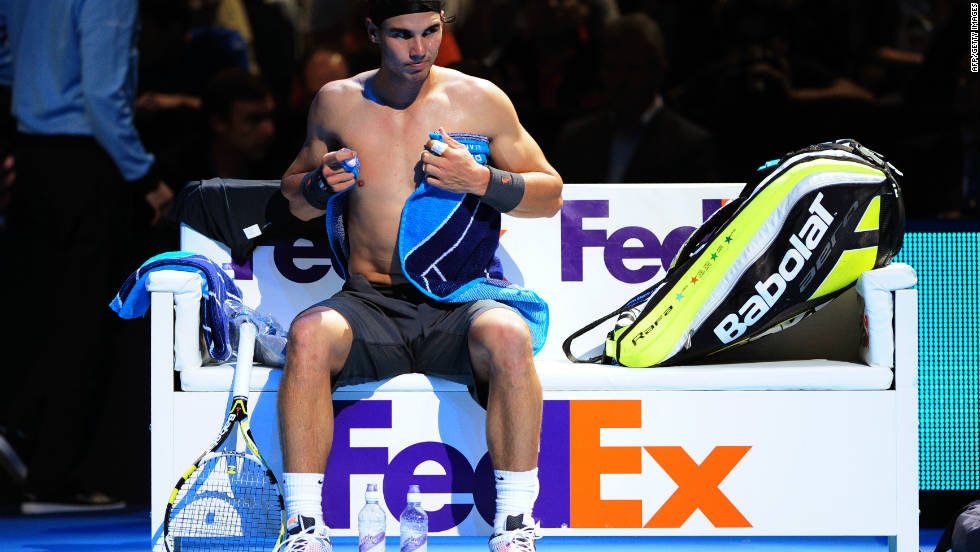 The event provides good exposure for sponsors such as FedEx, which has naming rights for the players' benches. World No. 2 Rafael Nadal towels himself dry as he changes his shirt during his opening win against Mardy Fish.