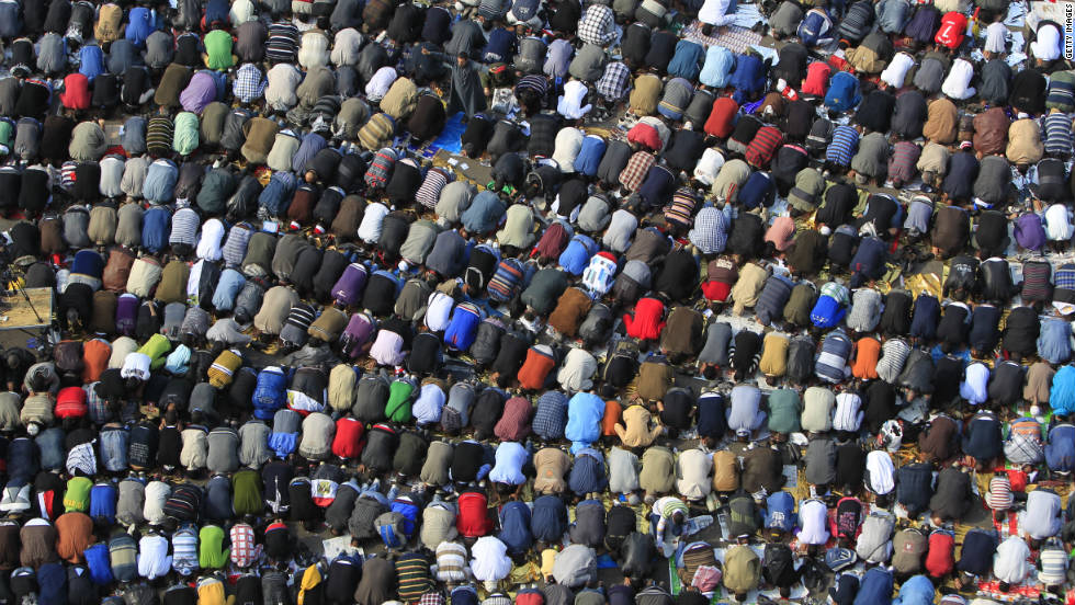 Demonstrators in Tahrir Square kneel during Friday prayers. Egypt's military rulers named Kamal Ganzouri to serve as prime minister until at least January, when parliamentary election results should be finalized.
