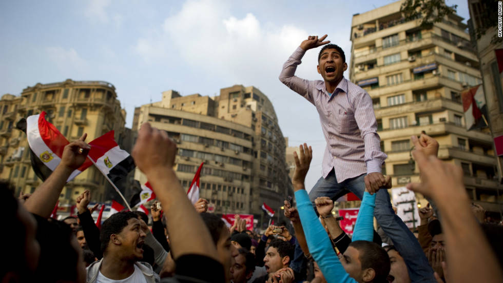 A protester leads chants Friday, November 25, in Cairo's Tahrir Square, where sometimes-violent rallies have taken place for a week. Egyptian military leaders said Thursday that parliamentary elections scheduled for Monday, November 28, will take place as planned, despite recent violence that claimed dozens of lives.