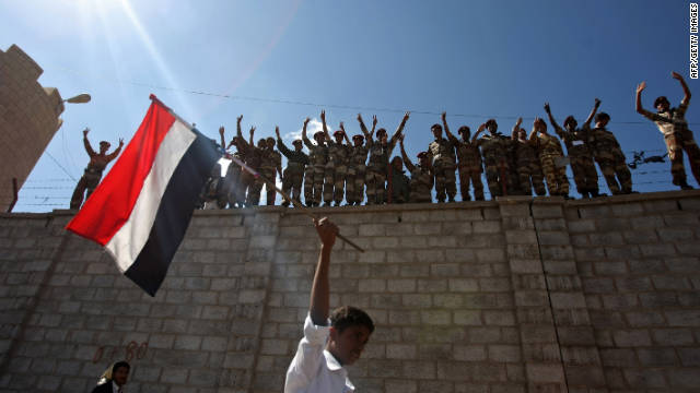 Dissident Yemeni protesters shout slogans as a protestor waves a Yemeni flag in Sanaa on Saturday.