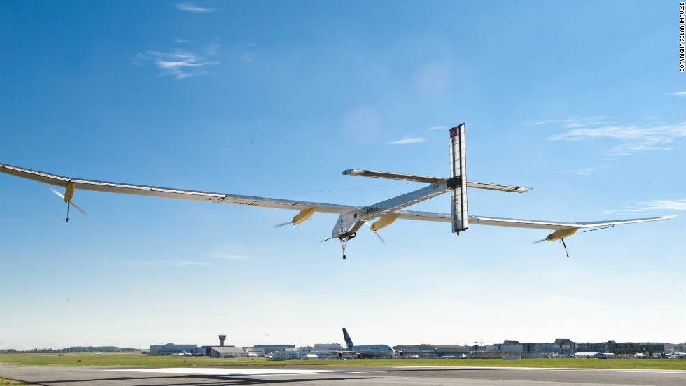 The world's first solar airplane, Solar Impulse, flies into the airshow from Brussels after a 16-hour journey.