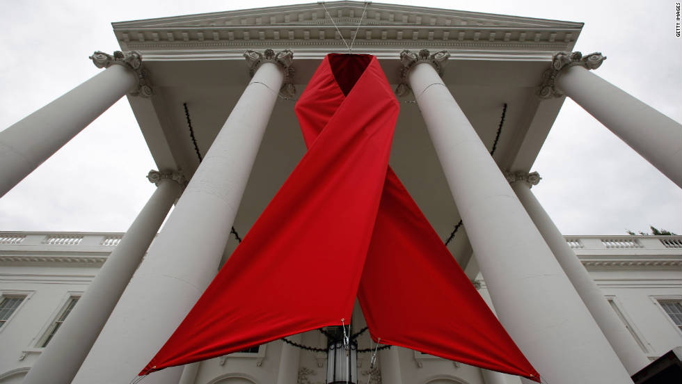 A red ribbon is hung between columns on the north side of the White House to commemorate World AIDS Day November 30, 2010 in Washington, DC.