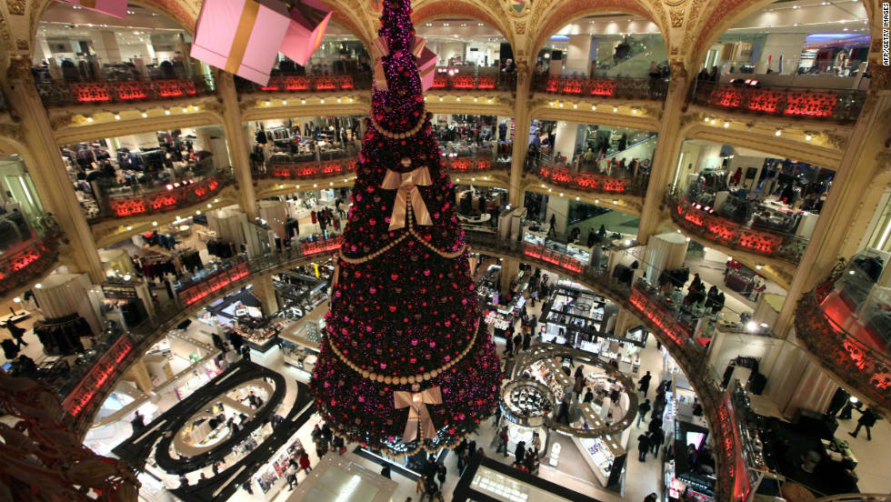 A decked-out Christmas tree towers over the Galeries Lafayette department store.
