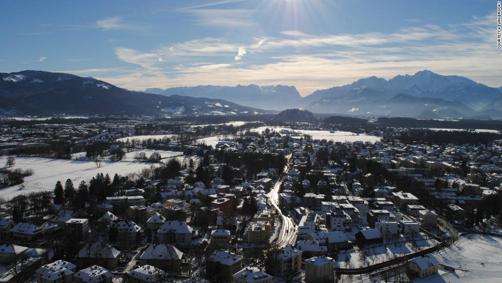 """Kevin Brooks captured this striking panorama of Salzburg. """"Climate change has settled in on the region and the magnificent winter season is having a progressively shorter span,"""" he says. He adds: """"The winter period is most beautiful in the town center where a winter carnival takes place each year."""""""