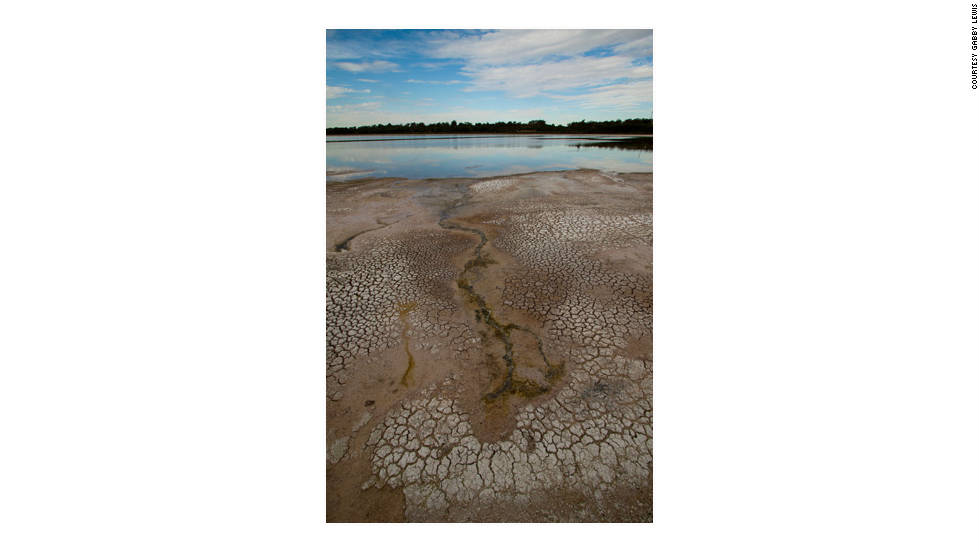 """Lake Walyungup, a salt lake in Western Australia, was photographed by Gabby Lewis. She says the sparse environment supports wildlife including the black swan, Western gray kangaroos and some freshwater long-necked tortoises. But she says: """"I have watched the water levels of the lake decline over the past 10 years that I've been in the area and believe it's because of the declining winter rainfall."""""""