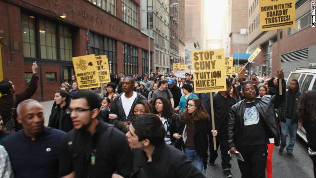 Demonstrators, joined by members of the Occupy Wall Street movement, march near Baruch College to protest proposed tuition increases at CUNY on November 28 in New York.