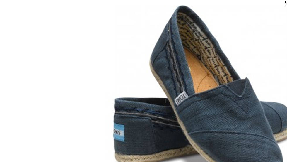 """If you want to give the gift of shoes this holiday season, <a href=""""http://www.toms.com/our-movement/movement-one-for-one"""" target=""""_blank"""">TOMS One for One program</a> donates one pair of shoes to a child in need for each for each pair of Toms that's purchased. The campaign also applies to <a href=""""http://www.toms.com/eyewear/our-movement/"""" target=""""_blank"""">TOMS Eyewear.</a> Each pair of glasses purchased will help restore sight to people in need by providing medical treatment, prescription glasses or sight-saving surgery."""