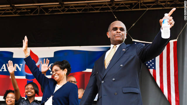 Herman Cain kicks off his presidential campaign with his wife, Gloria, at a May rally in Atlanta.