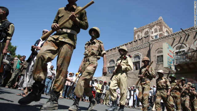 Yemeni soldiers loyal to President Ali Abdullah Saleh march in front of anti-government protestes in Sanaa on October 18, 2011.