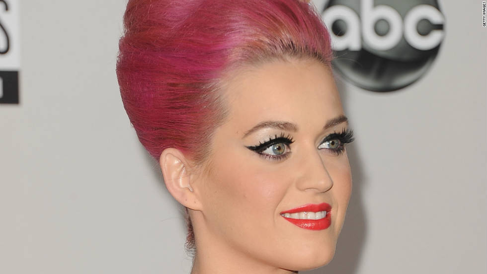 "The pop star sports a bright pink updo at the American Music Awards on November 20. Perry was first spotted with bubblegum locks in August. She showed off the wild hue -- with help from some <a href=""http://marquee.blogs.cnn.com/2011/08/29/celebs-make-up-for-gagas-tame-vma-look-with-eccentric-outfits/"" target=""_blank"">unconventional hair accessories</a> -- at MTV's Video Music Awards."