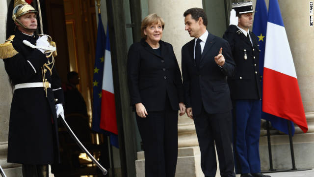 French President Nicolas Sarkozy welcomes German Chancellor Angela Merkel  at Elysee Palace on December 5, 2011 in Paris, France. The two leaders are meeting in an attempt to align their positions on the Euro Zone, in what will be a crucial week which will see a variety of meetings involving the ECB and European leaders ahead of the EU summit to be held in Brussells on Friday.
