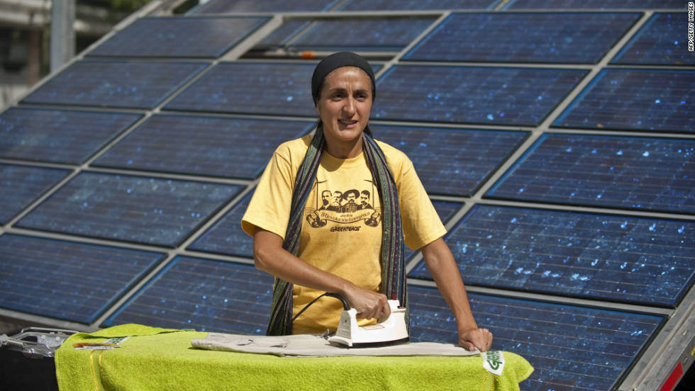 Argentinean actress and Greenpeace activist Barbara Torres using an iron powered by a solar battery. Like TVs, radios and mobile-phone chargers, irons are low-voltage electrical devices meaning their energy needs can be easily and sustainably met by solar power sources.