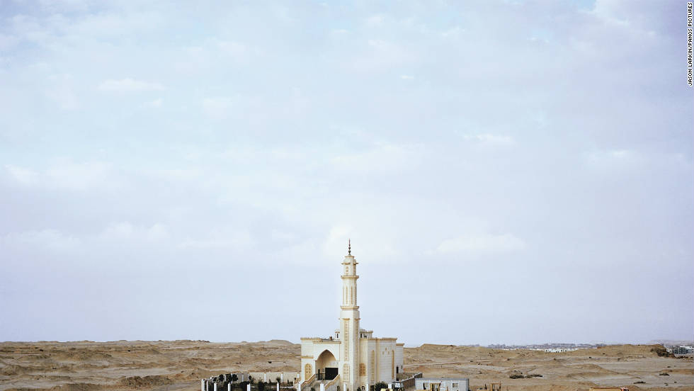 A newly-built mosque sits on land earmarked for development on the outskirts of New Cairo. Mosques are often one of the first buildings to appear when satellite cities begin taking place, in order to provide manual labourers with somewhere to pray during working hours