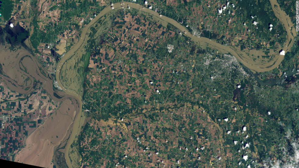 "The<a href=""http://edition.cnn.com/2011/US/05/21/flooding/index.html""> flooded outline</a> of the Mississippi River can be seen meandering into the left edge of this NASA image, with the Ohio River snaking north and east. Parts of the Mississippi experienced its worst floods since 1933 according to the WMO."