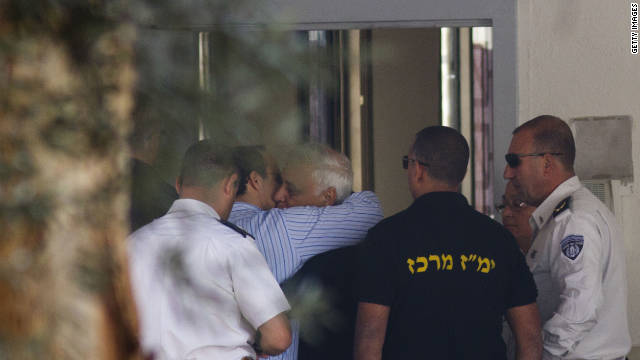 Former Israeli President Moshe Katsav hugs his son before starting a 7 year prison sentence for rape and sexual offenses.