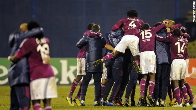Lyon players celebrate their remarkable 7-1 victory at Dinamo Zagreb to reach the last 16 of the Champions League.