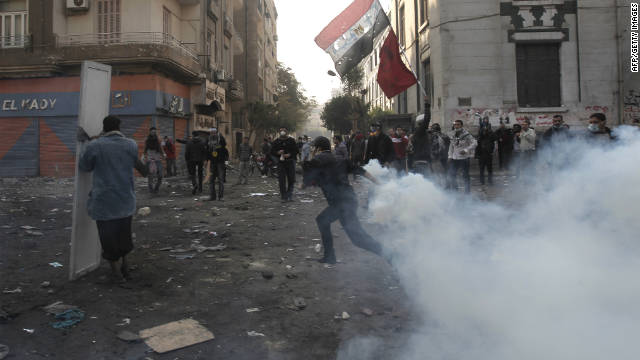An Egyptian protester runs from tear gas during clashes with riot police in Cairo on November 23.