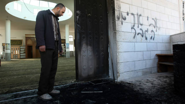 A Palestinian man inspects damage to a mosque in the West Bank village of Bruqin near Nablus on December 7.