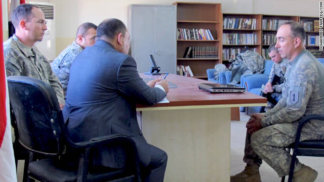 Rosenblatt, left, sits with other attorneys in Iraq, as they work to bring charges against a suspected insurgent.