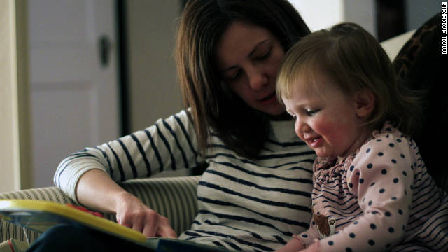 Rosenblatt's wife, Alexandra, and their daughter, Harper, read a book together.
