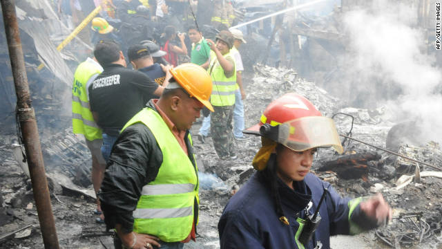 The plane crash, at a slum in the Philippine capital Manila, sparked a fire which left at least 13 dead and 20 wounded.