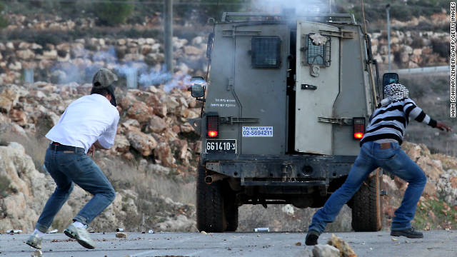 An Active Stills photo shows a tear gas canister being fired by Israeli troops toward Palestinian protester Mustafa Tamimi, left.
