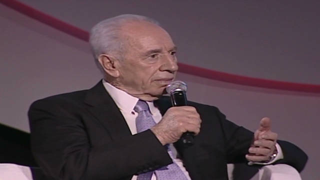 Peres: Syria's Assad 'a killer'
