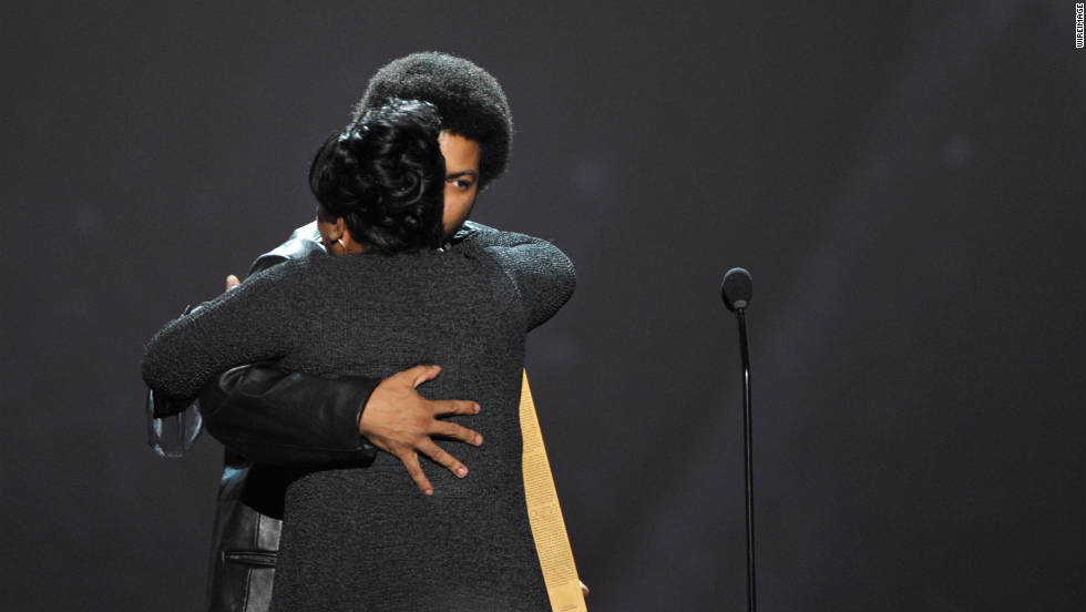 Rapper Ice Cube hugs CNN Hero Diane Latiker as she's recognized on stage.