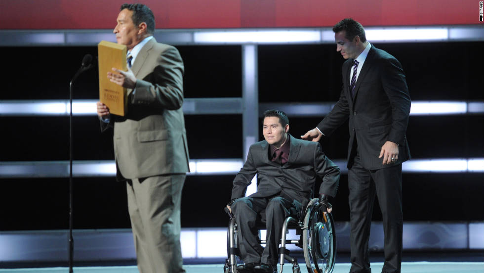 Eddie Canales asks the audience if he can bring his son onstage to share the award with him. His son was paralyzed during a high school football game in 2001. Today, Canales' nonprofit, Gridiron Heroes, provides emotional and financial support to high school football players who've sustained life-changing spinal cord injuries.