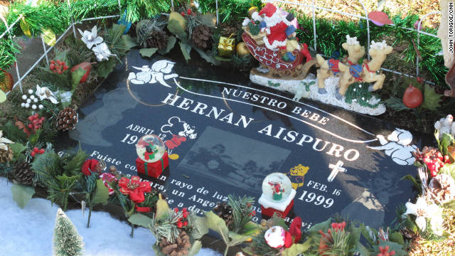 Every year, the Perezes decorate Hernan's grave site for Christmas.