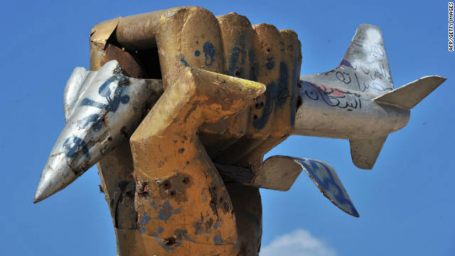 Libyan rebels cut down Moammar Gadhafi's golden fist after seizing his compound in Tripoli.