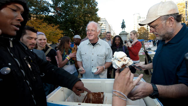 Ben Cohen, center,  and Jerry Greenfield dish out  ice cream at Occupy D.C . in  McPherson Square on November 8.