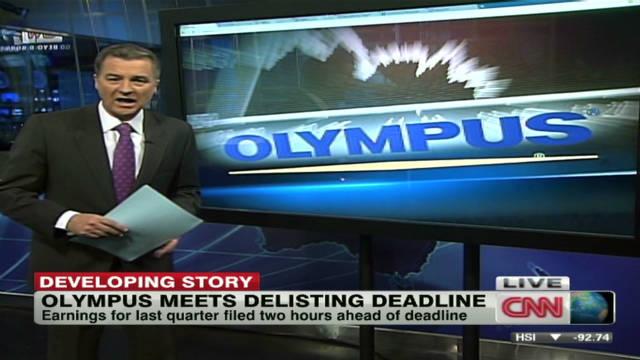 Olympus survives de-listing threat