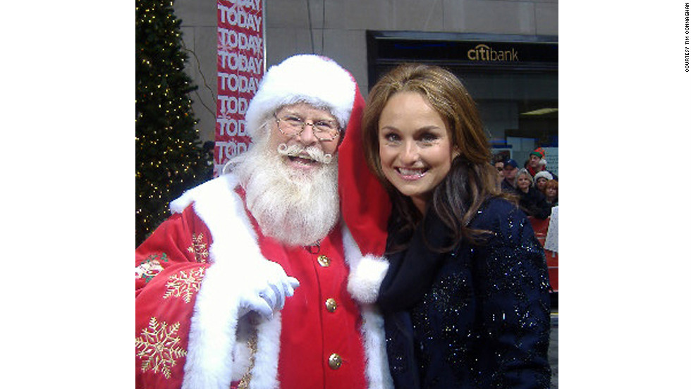 Tim Connaghan, seen here with chef and TV personality Giada De Laurentiis, is in the business of selling Santa. Not only is he out there, he's booking gigs for up to 2,000 others.
