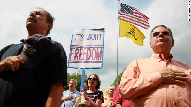 Tea Party supporters sing the National Anthem before the start of a Tea Party Express rally.