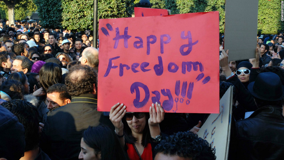 Tunisians hold banners during a rally on February 14, 2011 in Tunis on Valentine's Day celebrating a month of freedom.